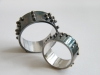 Oxidized sterling silver wedding rings with Braille text