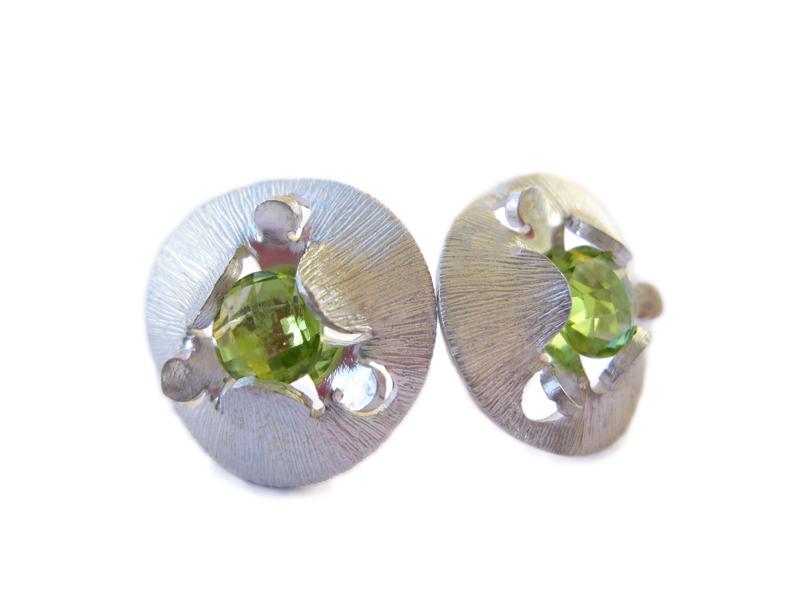 Sterling silver stud earrings with peridot.